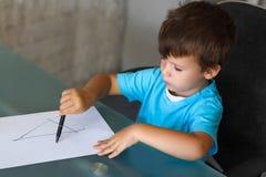 Preschooler boy learn writing letters. Education Stock Photography