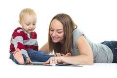 Preschooler boy mother read Stock Photography
