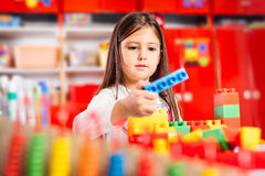 Preschooler child playing with colorful toy blocks. Stock Photo