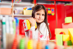 Preschooler child playing with colorful toy blocks Royalty Free Stock Image
