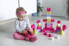 Preschooler child playing with colorful toy blocks Royalty Free Stock Images