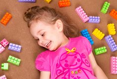 Preschooler child playing with colorful toy blocks royalty free stock photos