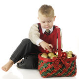 Preschooler with a Christmas Basket Royalty Free Stock Photos