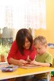 Preschooler con los bloques de madera Fotografía de archivo libre de regalías
