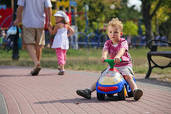 Preschooler driving his toy vehicle Stock Photography