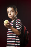 Preschooler eating apple Royalty Free Stock Photo
