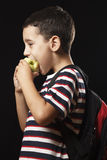 Preschooler eating apple Stock Photo
