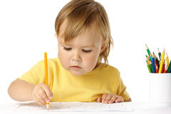 Preschooler focused on her drawing Stock Image