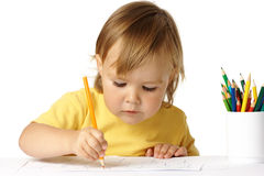 Preschooler focused on her drawing Royalty Free Stock Photo