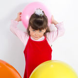 Preschooler girl with air balloons Stock Photography