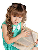 Preschooler girl with book Royalty Free Stock Photos