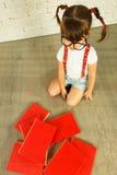 Preschooler girl with books Stock Photo