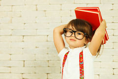 Preschooler girl with books Royalty Free Stock Image