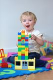 Preschooler girl building from plastic bricks Royalty Free Stock Photography
