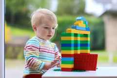 Preschooler girl building from plastic bricks Royalty Free Stock Photos