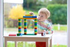 Preschooler girl building from plastic bricks Royalty Free Stock Images