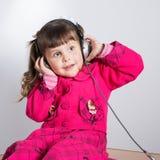 Preschooler girl in headphones Stock Photos