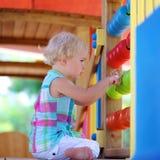 Preschooler girl learning at playground Stock Photos