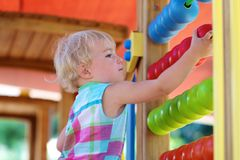 Preschooler girl learning at playground Royalty Free Stock Photo