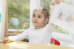 Preschooler girl in the nursery Royalty Free Stock Images