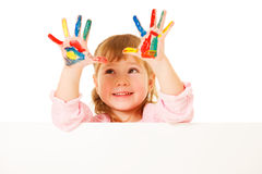 Preschooler girl with painted hands Royalty Free Stock Images
