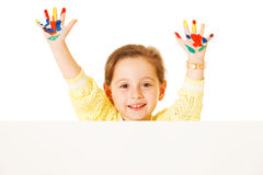 Preschooler girl with painted hands Stock Image