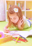 Preschooler girl painting with colorful pencil Stock Photo