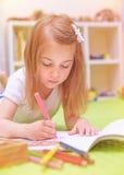 Preschooler girl painting in daycare Stock Photos