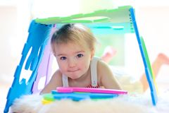 Preschooler girl playing at daycare Royalty Free Stock Photo