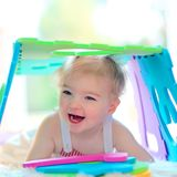 Preschooler girl playing at daycare Stock Images