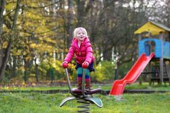 Preschooler girl playing in the park Royalty Free Stock Images
