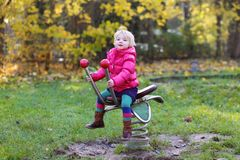 Preschooler girl playing in the park Stock Photo