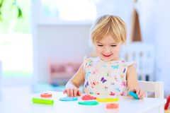 Preschooler girl playing with plasticine Royalty Free Stock Photography