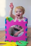 Preschooler girl playing with puzzles learning numbers Royalty Free Stock Photography