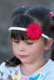 Preschooler girl posing with hair hoop outdoors in evening time Stock Photography