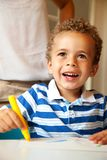 Preschooler Having Fun Coloring Stock Photo