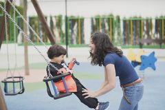 Swing fun in playground Royalty Free Stock Images