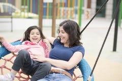 Swing fun in playground Stock Image