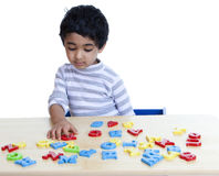 Preschooler Identifying Alphabets and Numbers Royalty Free Stock Image