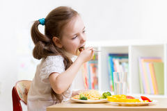 Preschooler kid eating healthy food at home Stock Photography