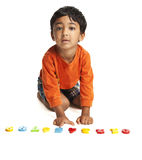 Preschooler Learning Numbers. Isolated, White Stock Images