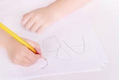 Preschooler learning to write alphabet. Close-up of a preschooler learning to write alphabet Royalty Free Stock Image