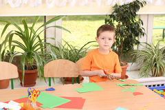 Preschooler and manual skills. 6 years old preschooler making some decoration stock photo