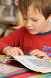 Preschooler reading book Stock Image