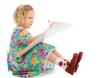 Preschooler sits drawing Stock Image