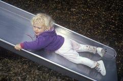 Preschooler on slide at pre-school,Washington, DC Royalty Free Stock Photos