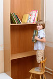 Preschooler stands on chair with book Royalty Free Stock Images