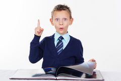Preschooler surprised boy with finger up Stock Photo