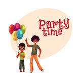 Preschooler and teenage black, African American boys, brothers with balloons Stock Photography
