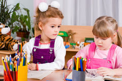 Preschoolers. Playing and painting with colored pencils Stock Photography